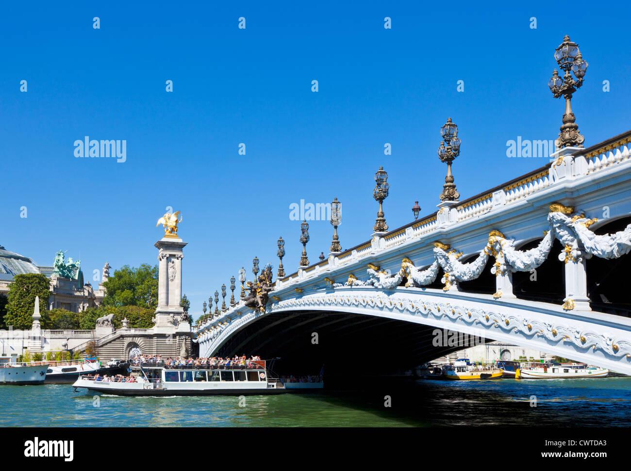 River Seine Cruise boat bateaux mouches under the Pont Alexandre III (bridge) Paris, France, Europe - Stock Image