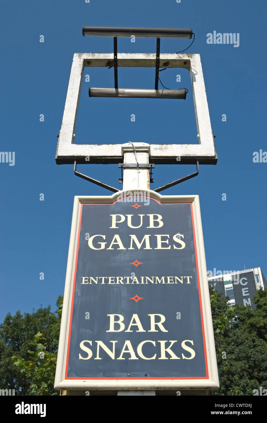 empty pub sign frame outside a closed pub with board below advertising pub games and bar snacks, hounslow, middlesex, - Stock Image