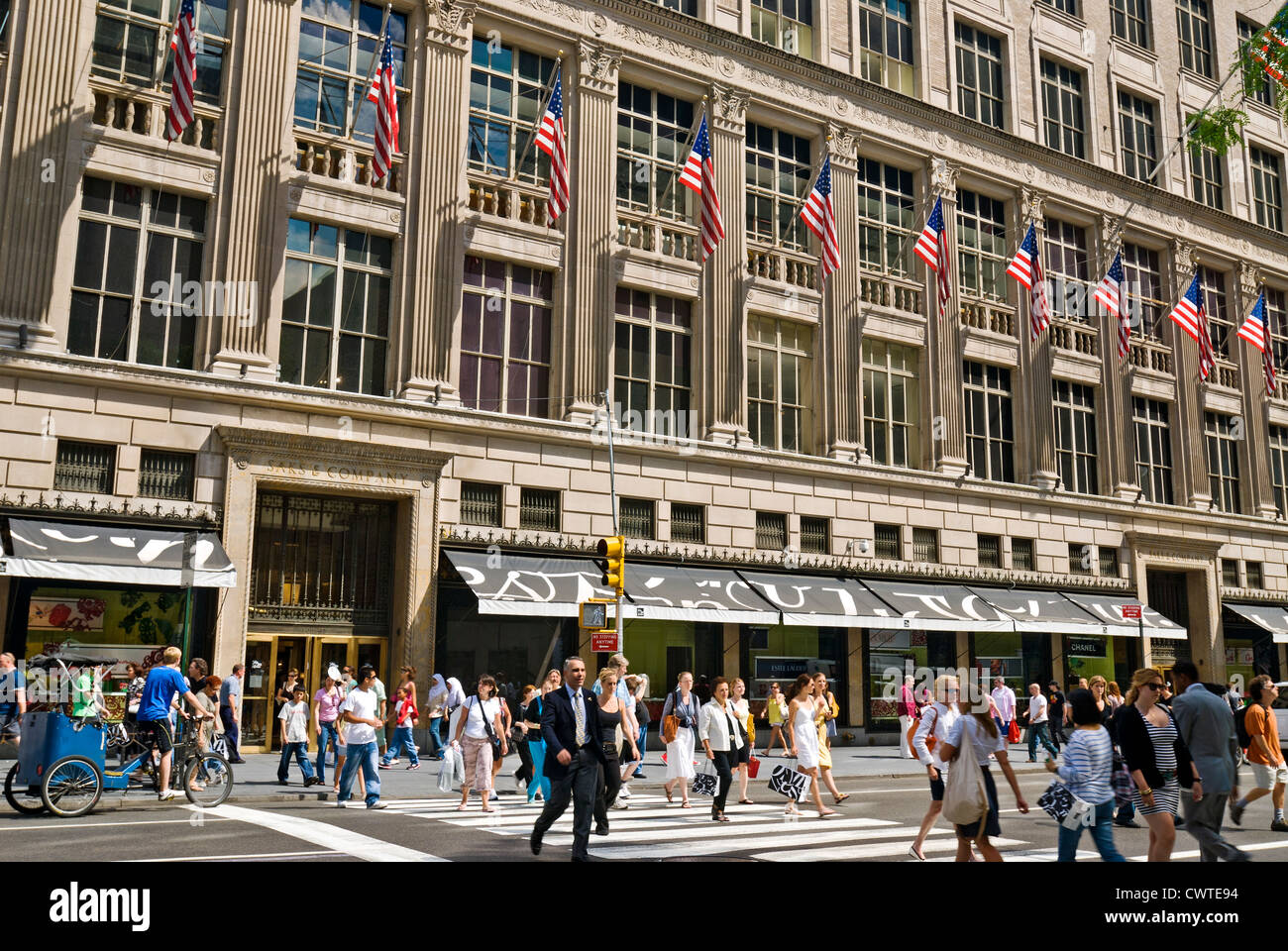 Saks Fifth Avenue Department Store and crowd of shoppers and Stock ... b4a2df083c28