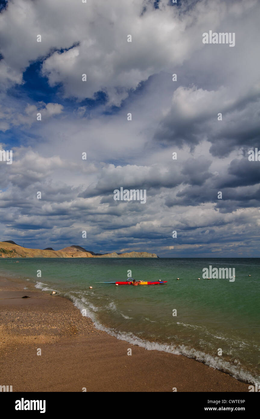 View of thunderstorm clouds above the sea - Stock Image