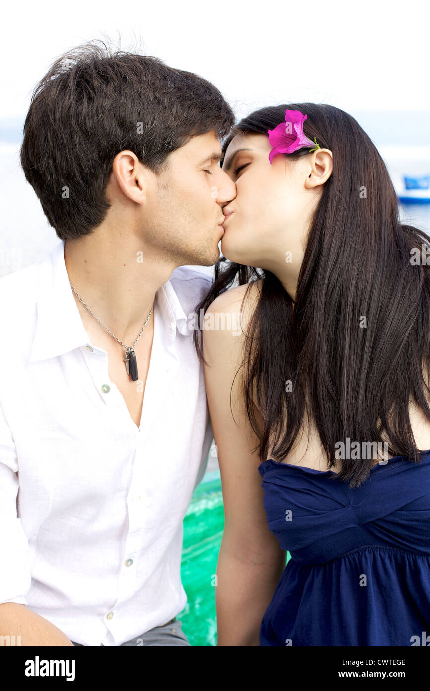 Happy couple kissing on a boad on a lake  - Stock Image