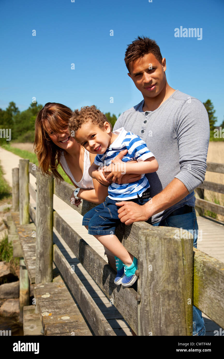 Couple and their little son enjoying time together on a sunny day - Stock Image