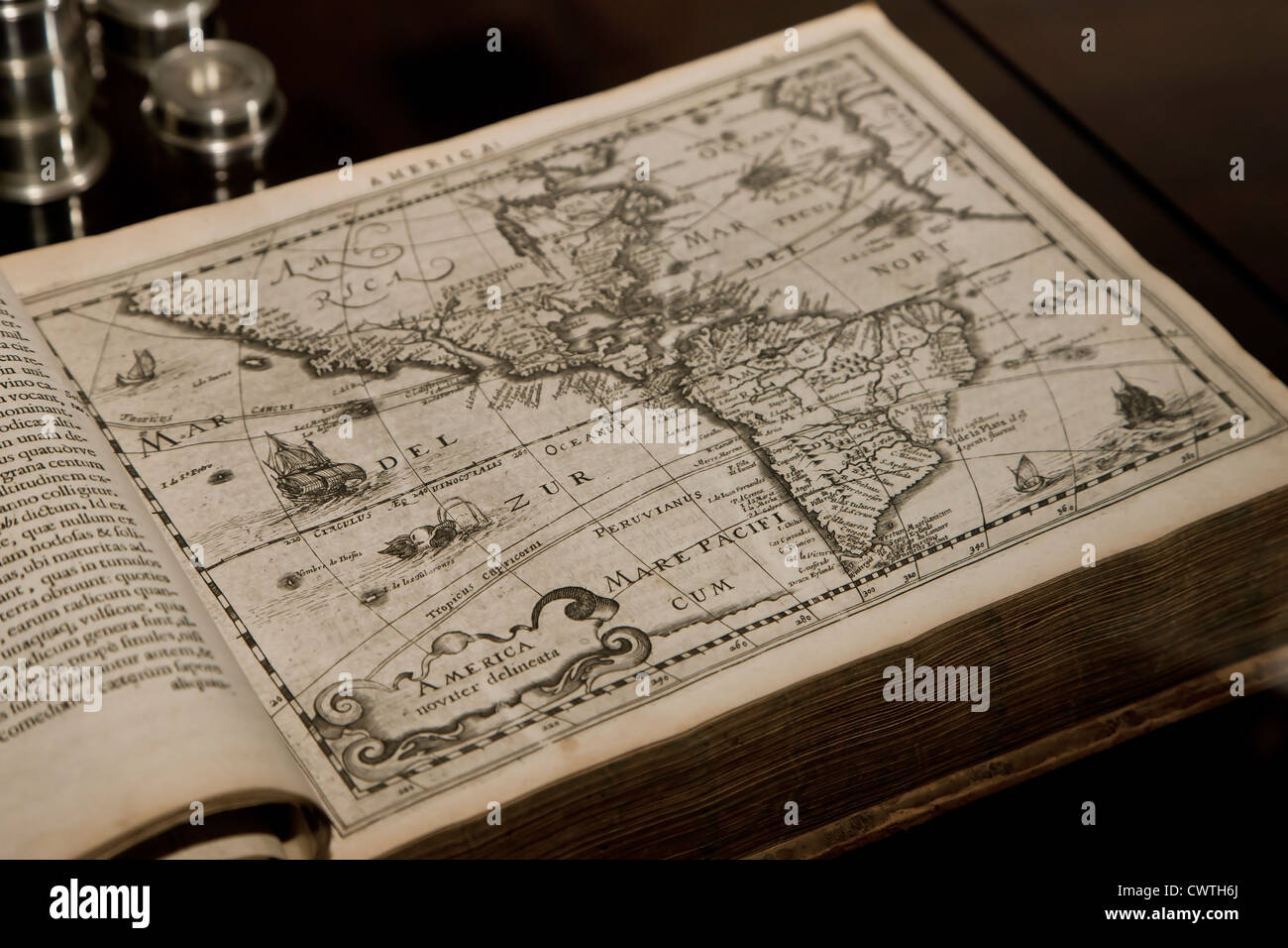 Old book with a distorted map of America - Stock Image