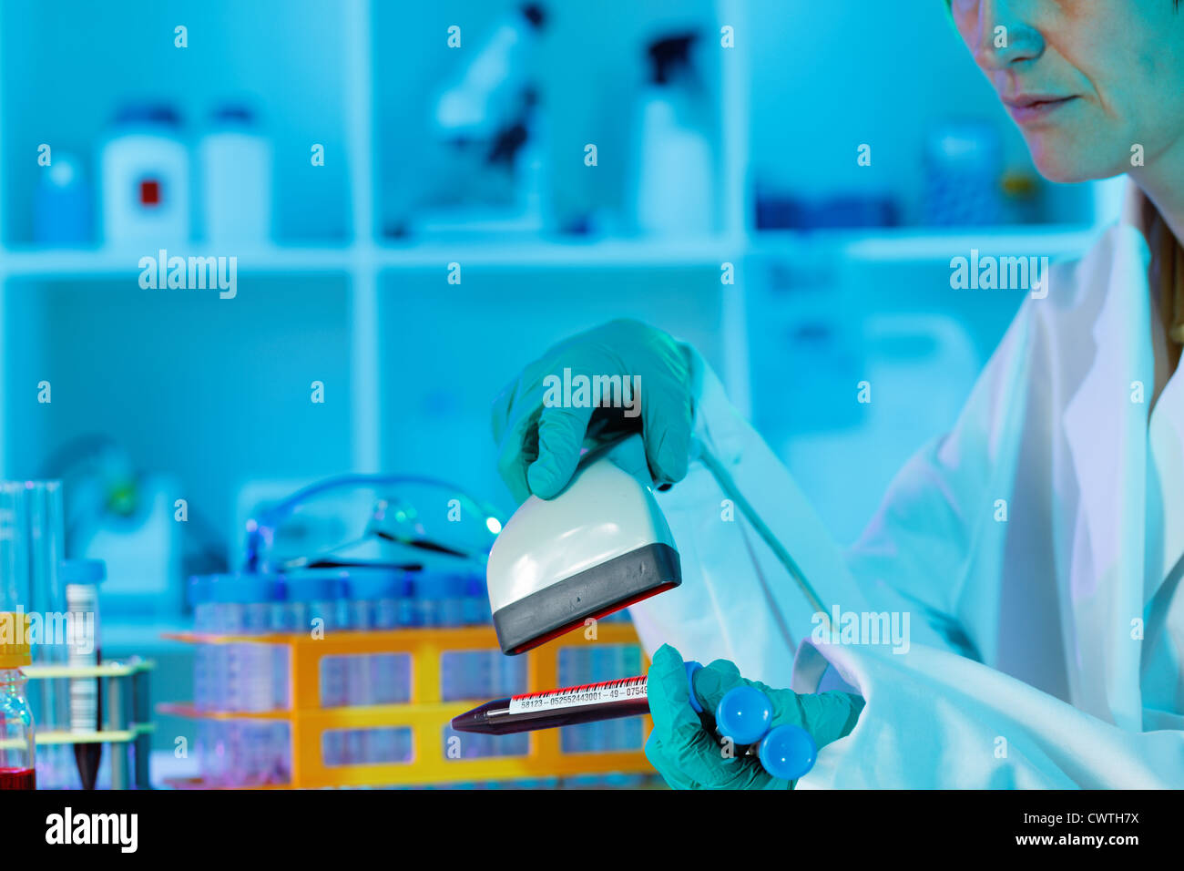 technician scans the sample tubes biological culture - Stock Image