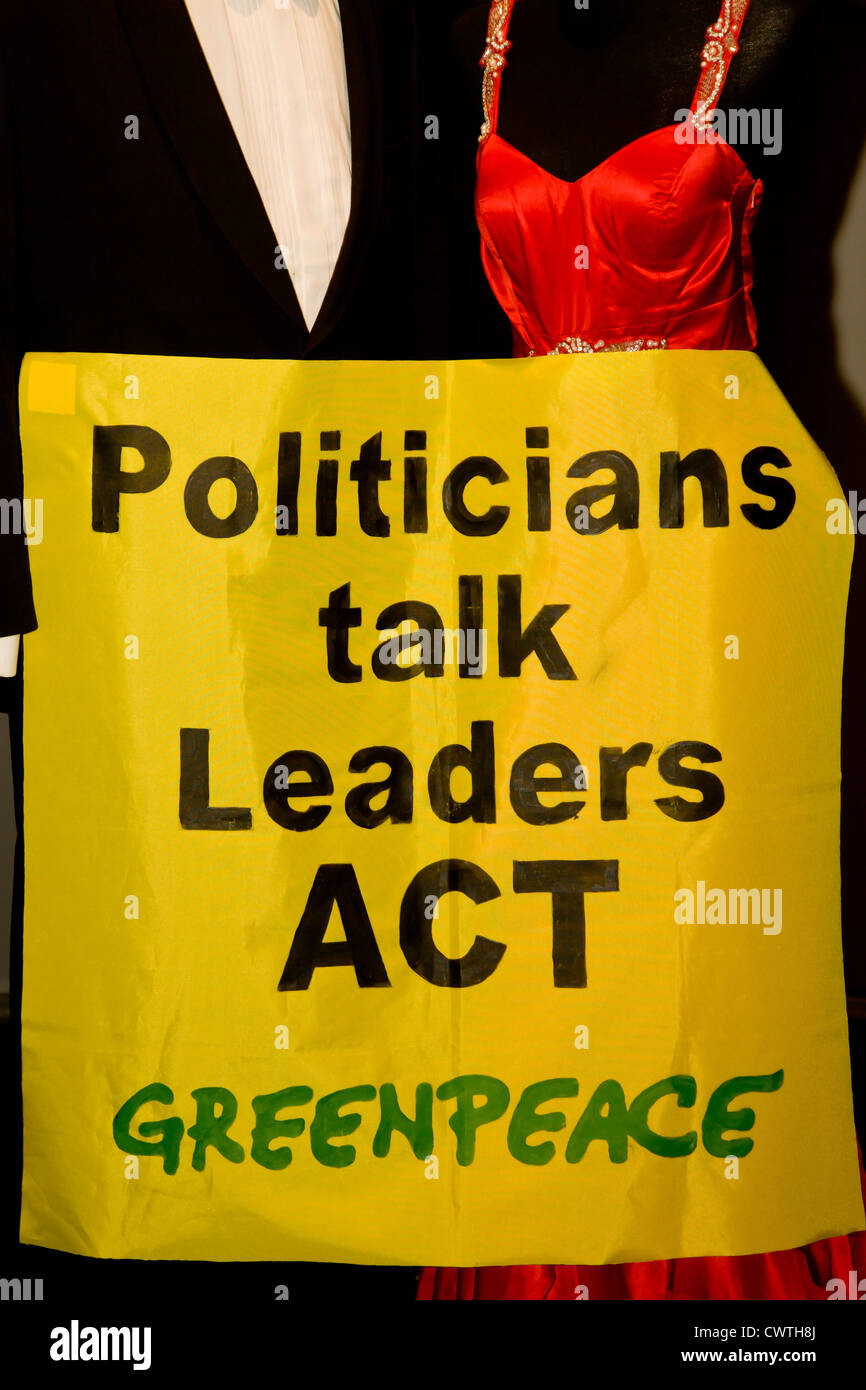 Greenpeace poster with the words Politicians talk leaders act - Stock Image
