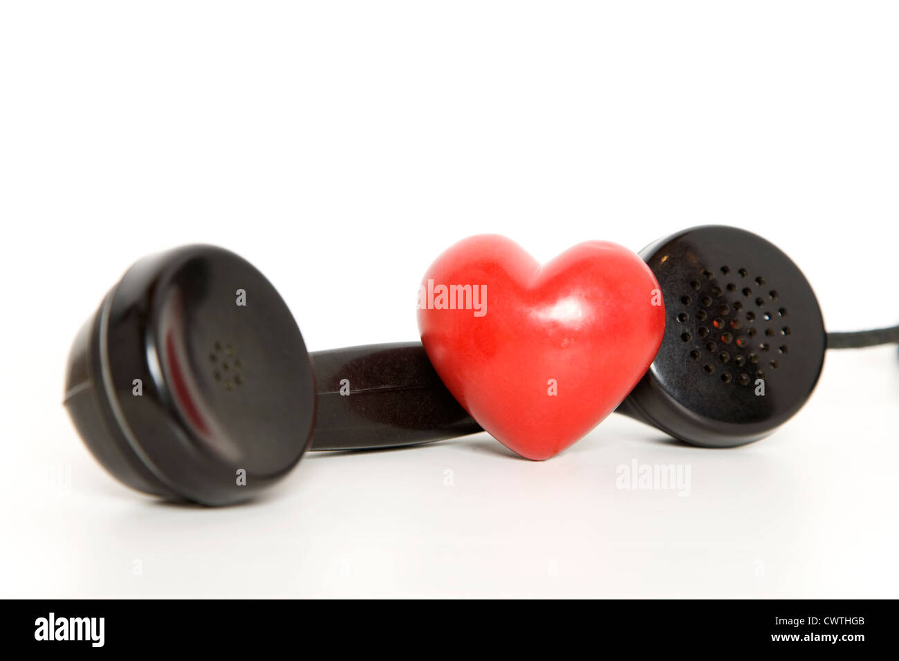 Heart with old-fashioned telephone receiver - Stock Image