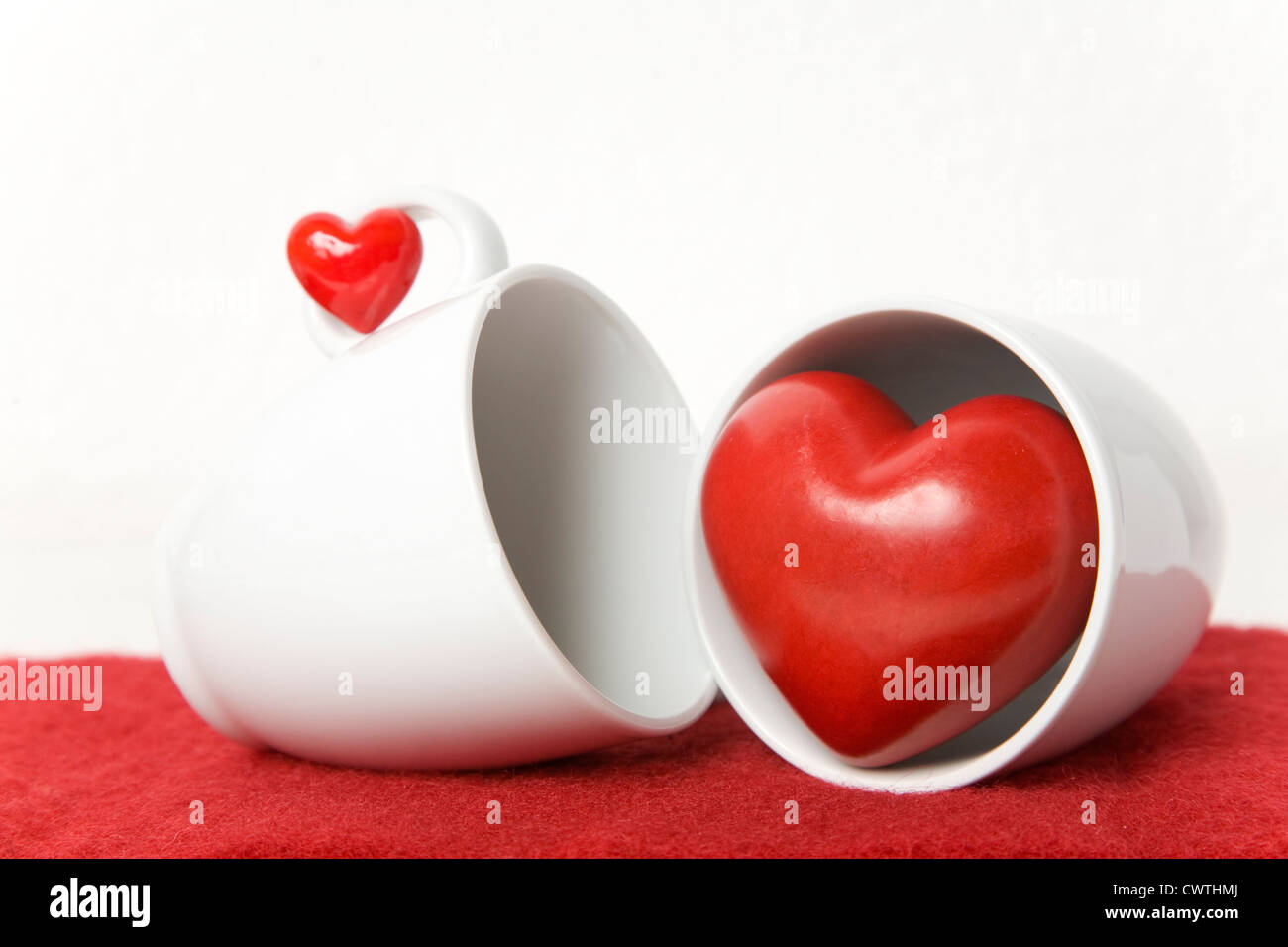Small and large heart with coffee cups Stock Photo