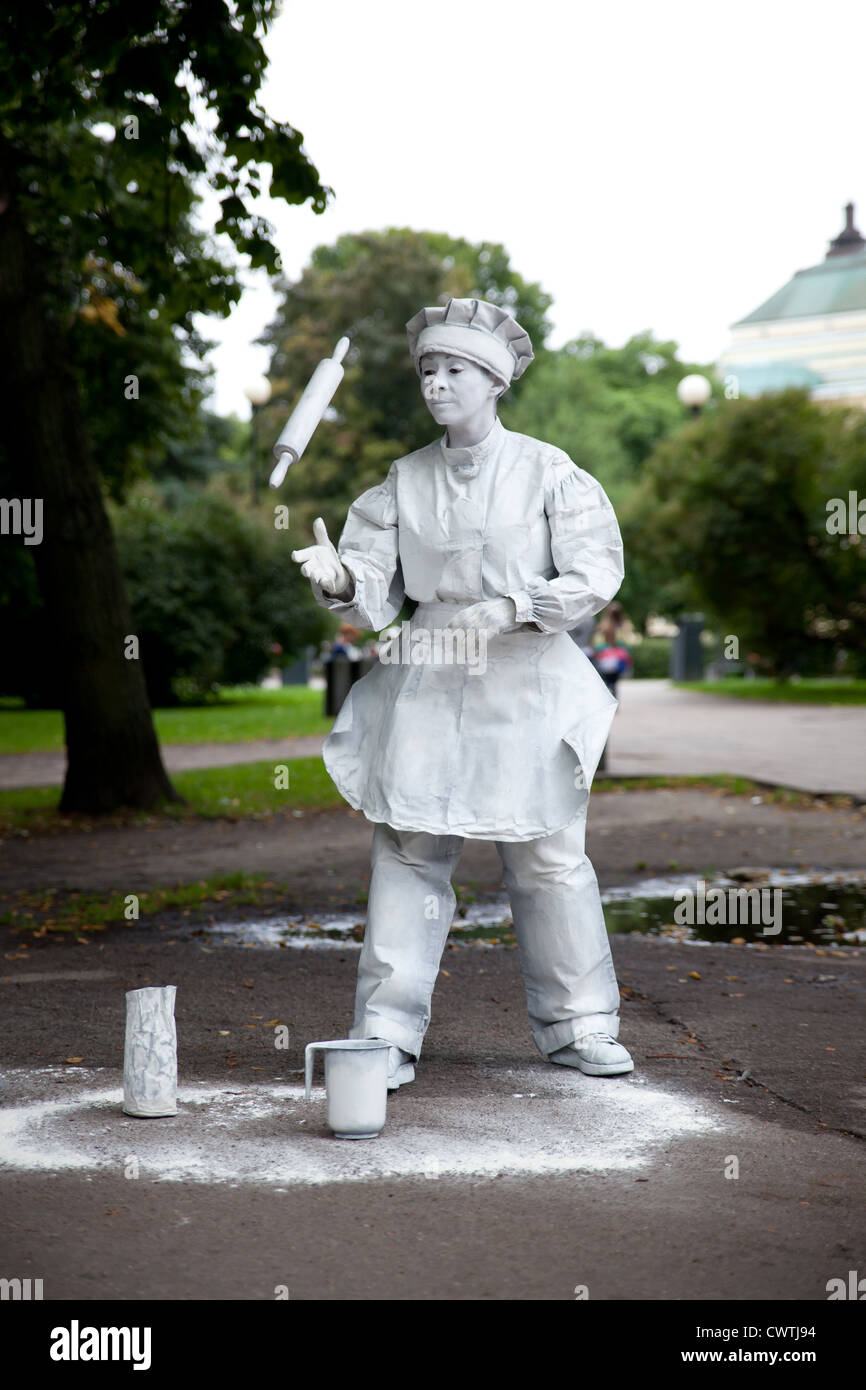 Street mime (baker character) acting on the streets of Tallinn, Estonia - Stock Image