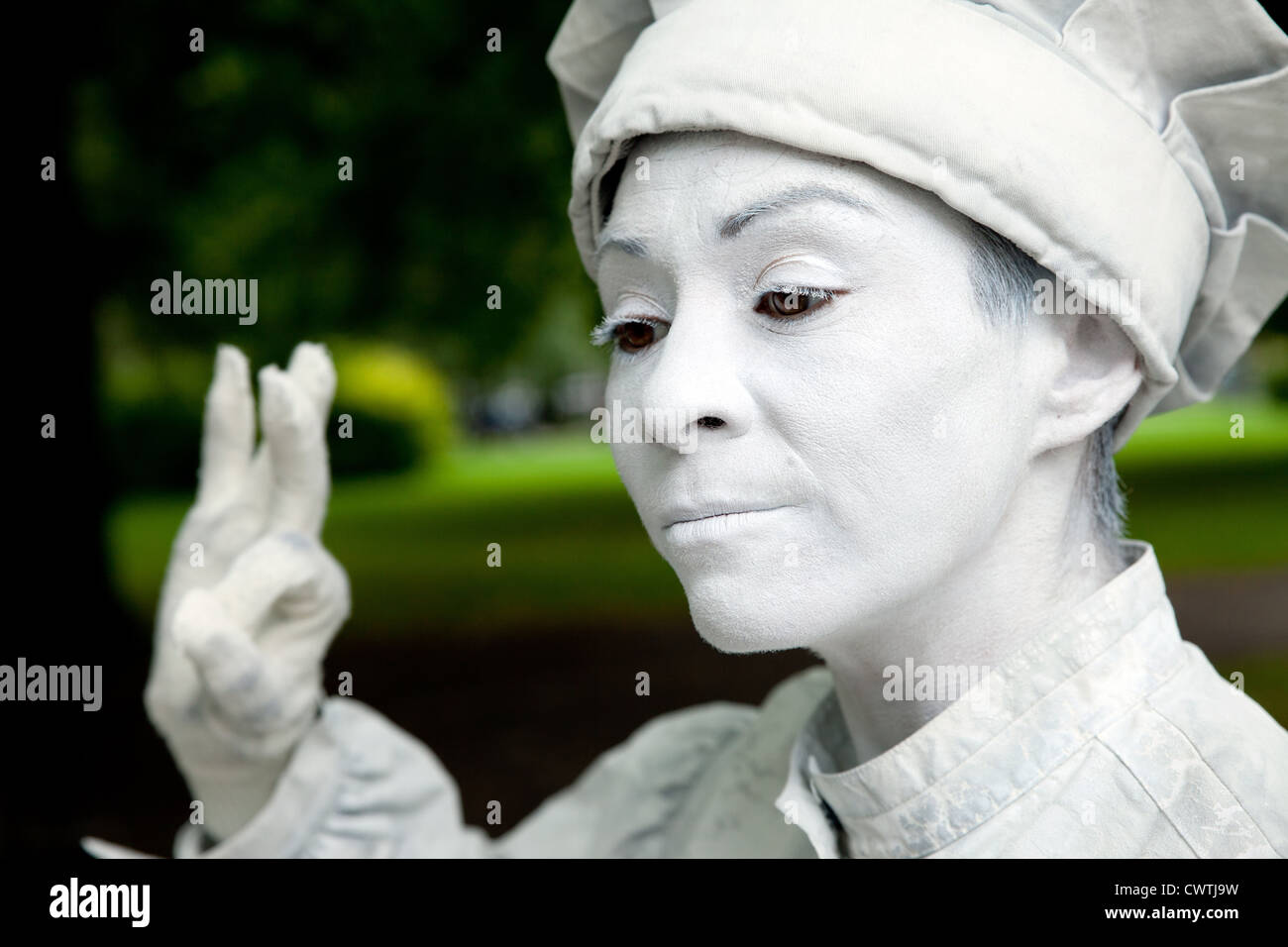 White street mime (baker character) performing. - Stock Image