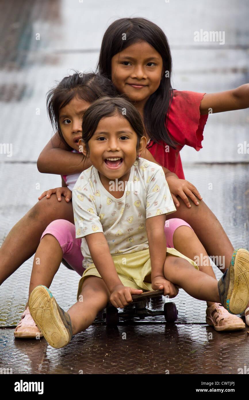 Amazonian Quechua girls have fun. - Stock Image