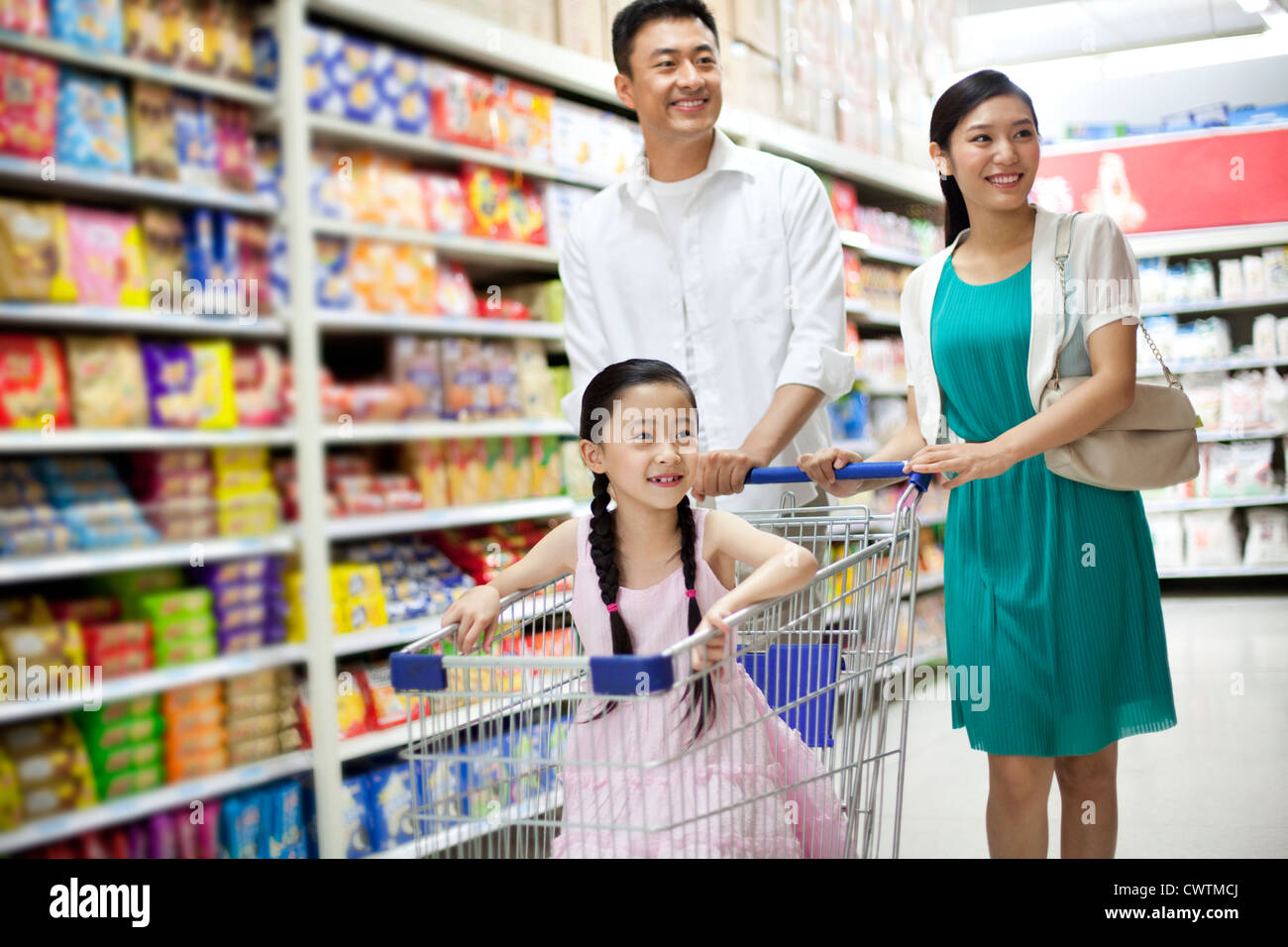 Family shopping in supermarket Stock Photo - Alamy