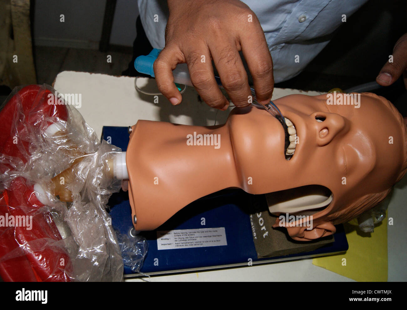 Doctor Explain how to give Artificial Respiration using Medical Devices to Dummy Patient model in Medical Exhibition - Stock Image