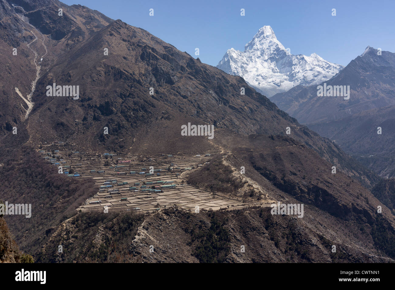 Khumjung village in Nepal with Ama Dablam in the background - Stock Image