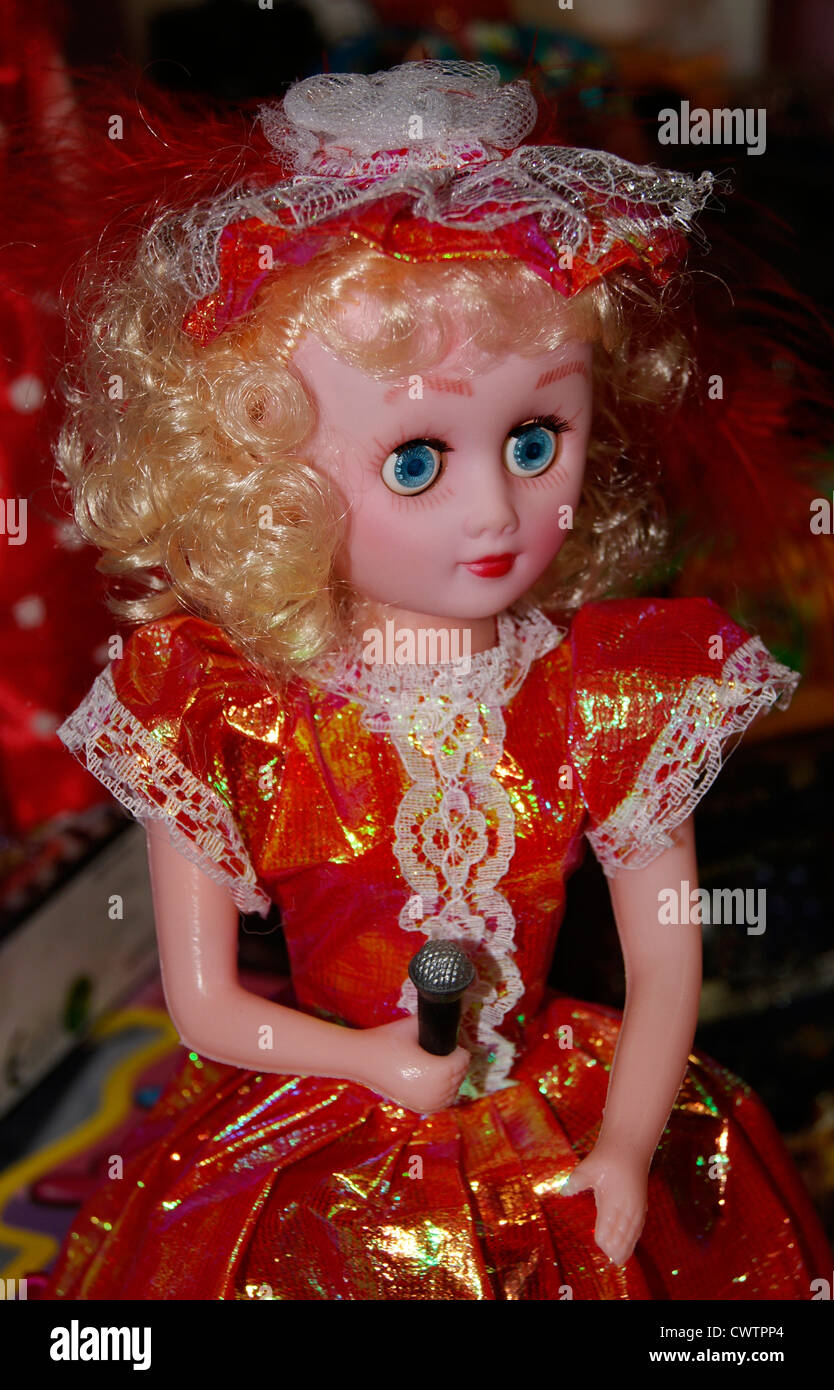 Cute Singing Doll Girl toy holding Mic in Hand - Stock Image