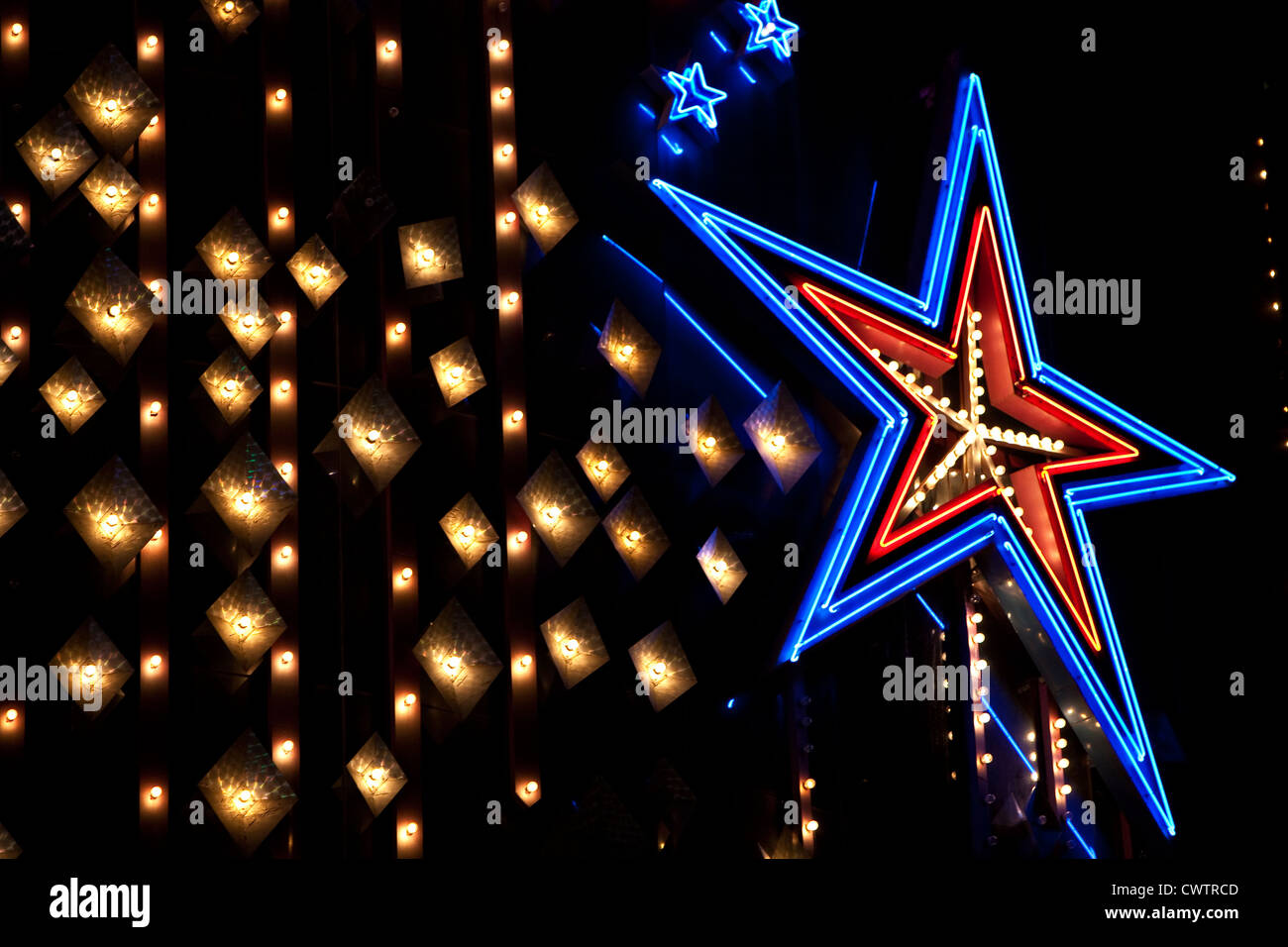 blue neon star light and white lights on a black background abstract - Stock Image