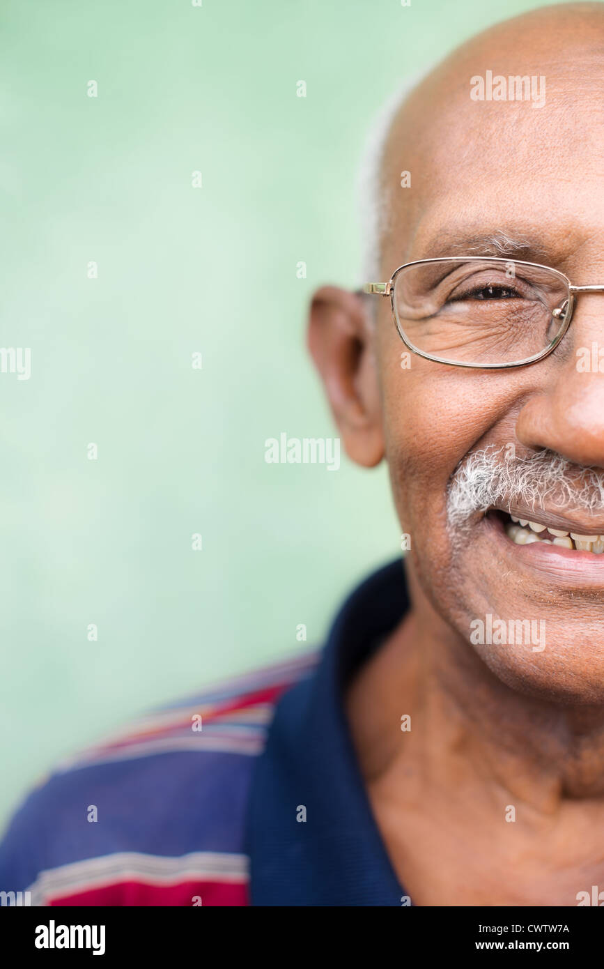 Seniors and feelings, elderly black man with glasses and mustache smiling. Cropped view, copy space - Stock Image