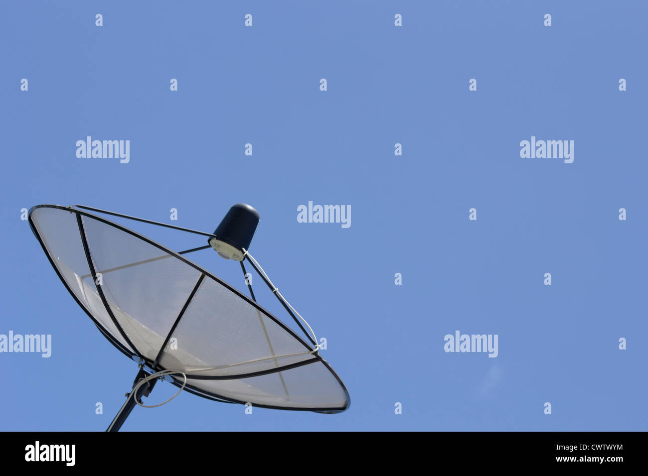 dish sattellite receiver against the blue sky - Stock Image