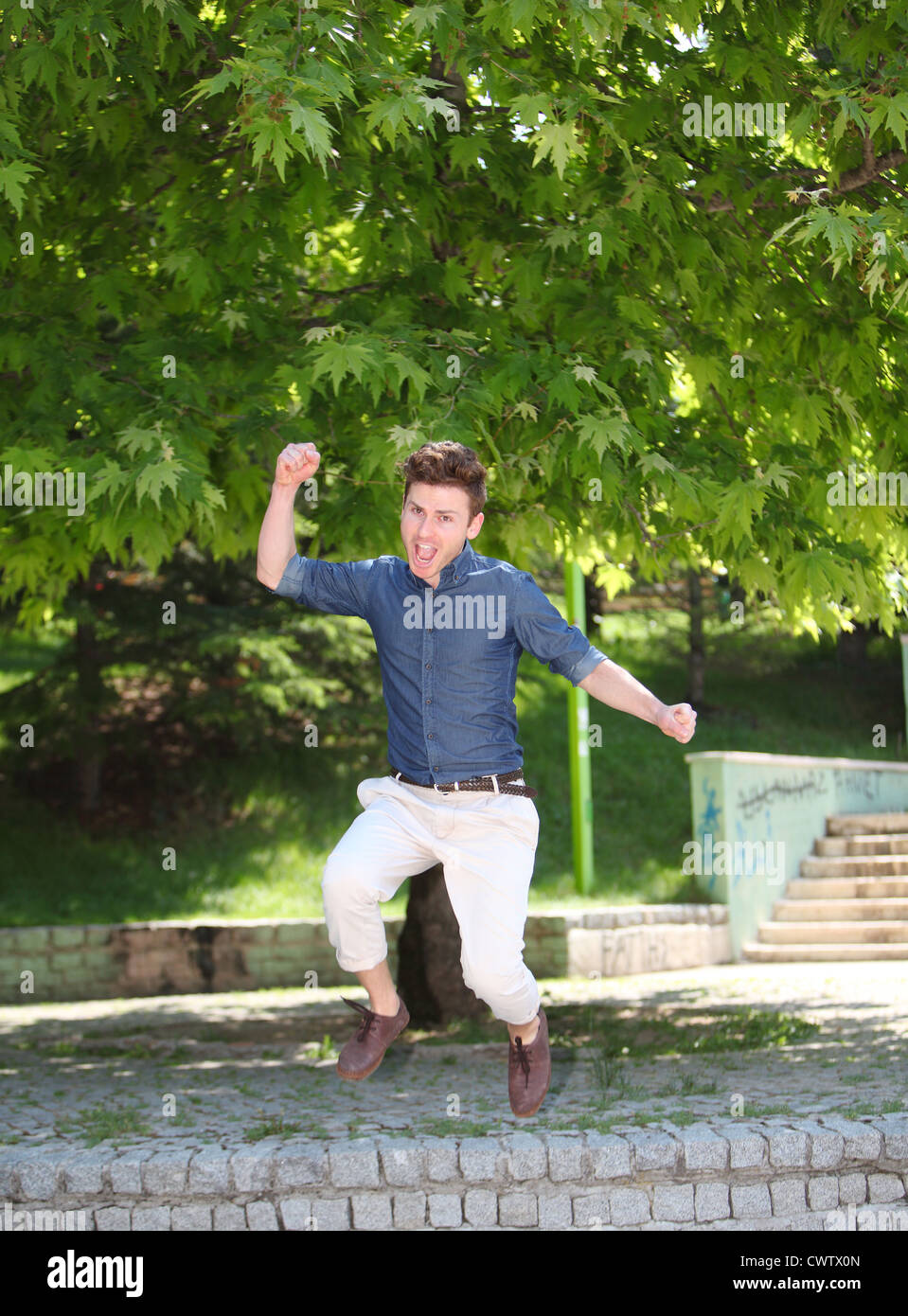 Jumping and happy red hair russian man - Stock Image
