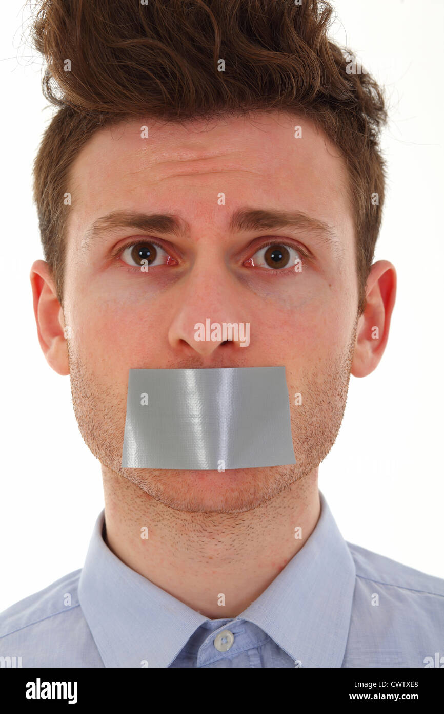 Young man scared with tape on mouth - Stock Image
