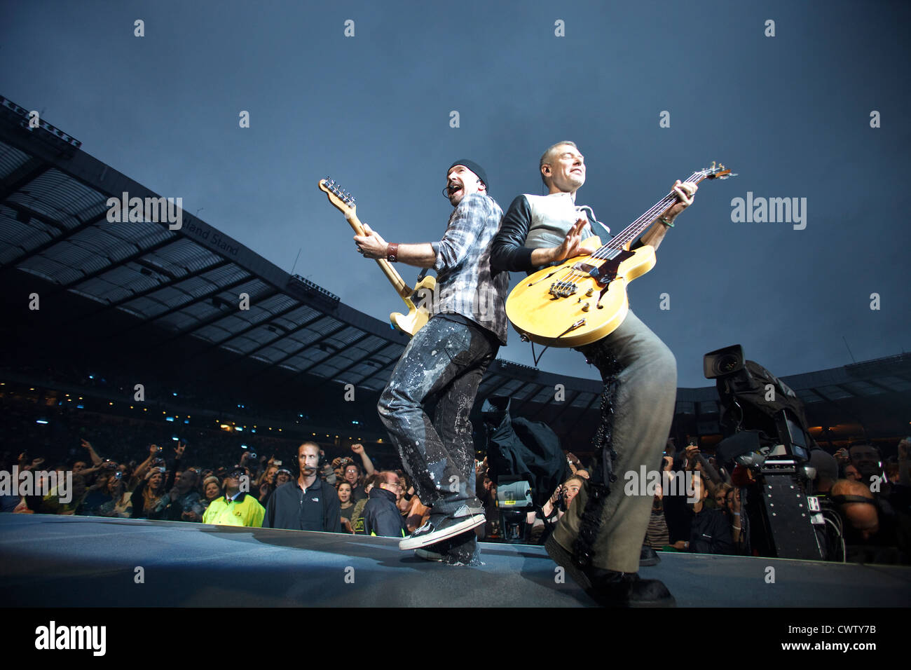 The Edge and Adam Clayton performing during The U2 360° Tour at Hampden Park, Glasgow, Scotland. - Stock Image