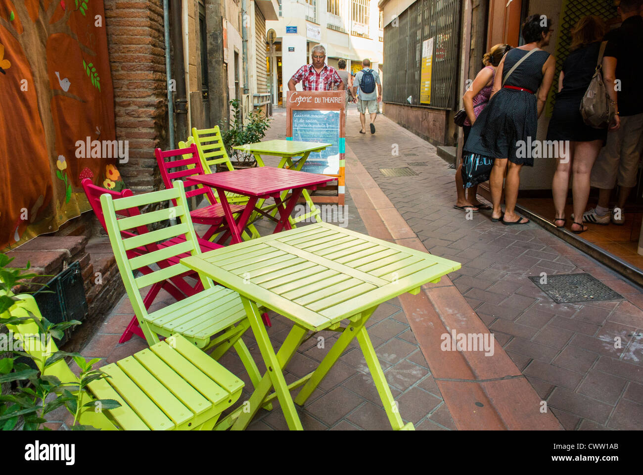 Perpignan, France, Colorful Cafe Bistro Tables And Chairs On Street  Terrace, In SOuth