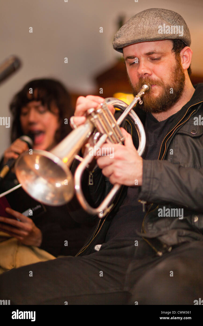 Trumpet player practicing with band - Stock Image