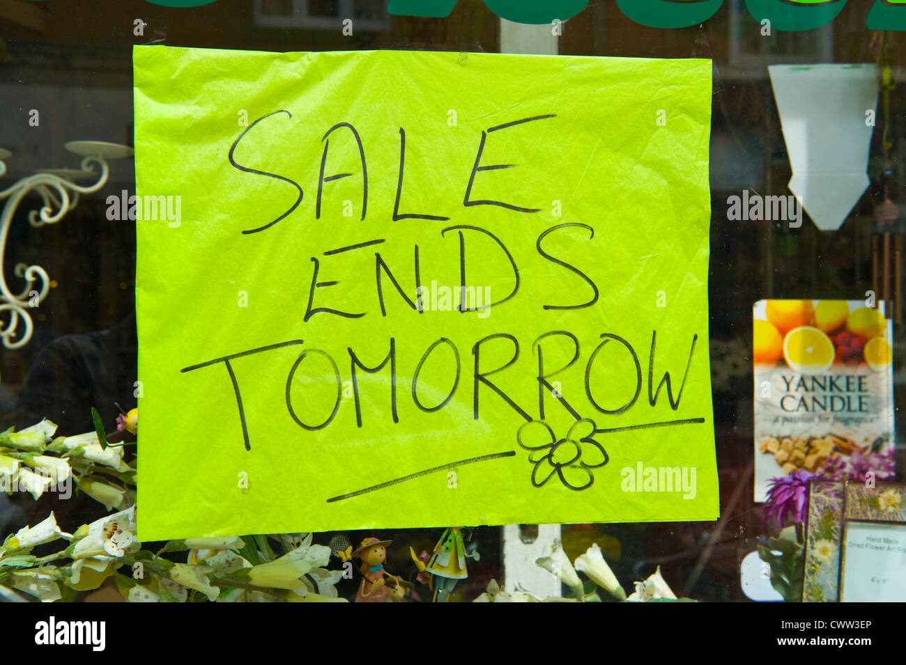 SALE ENDS TOMORROW sign in shop window Bromyard Herefordshire England UK - Stock Image