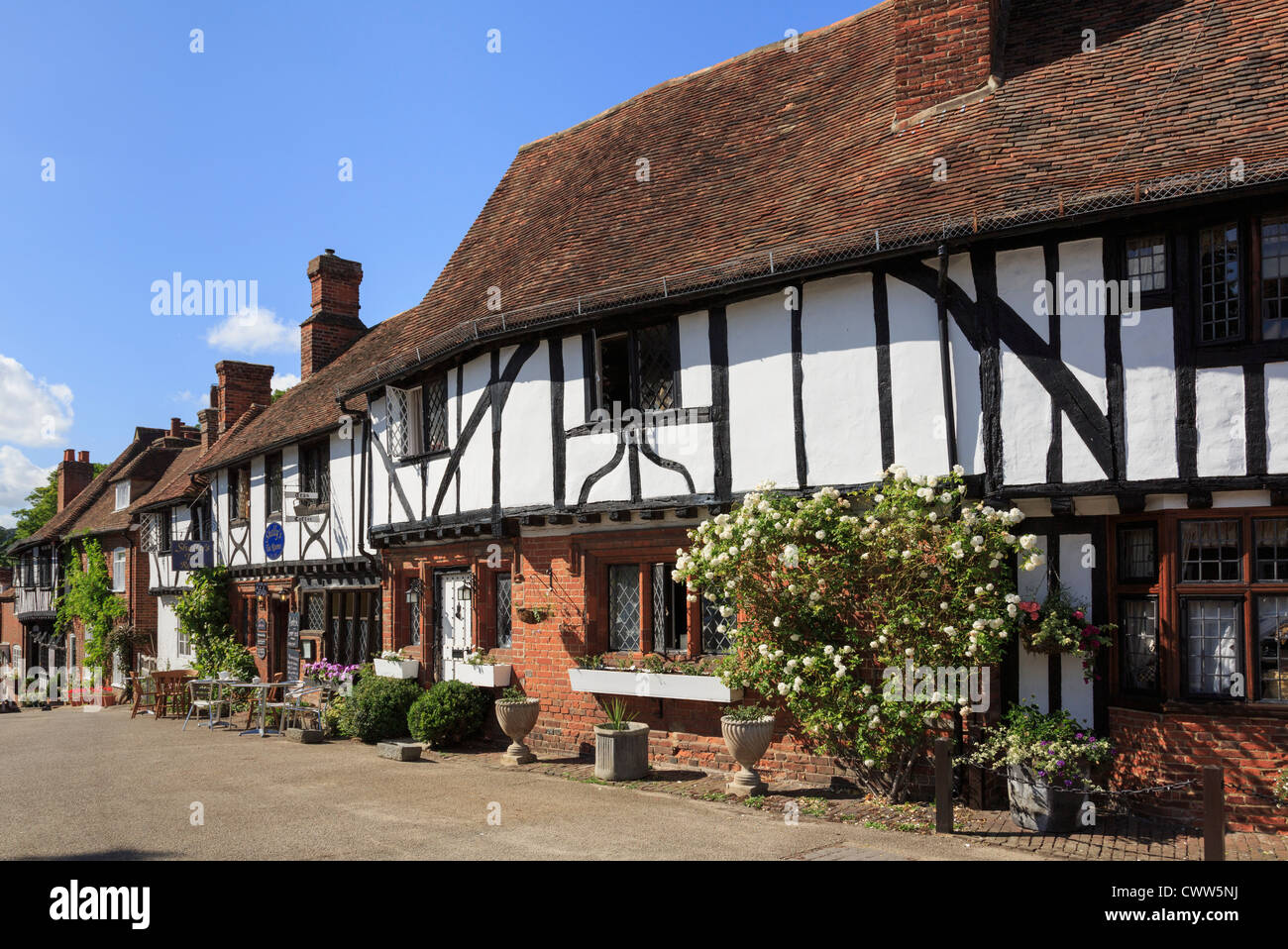Row of timber-framed Tudor houses in pretty picturesque medieval Kentish village square on the Pilgrims Way. Chilham, - Stock Image