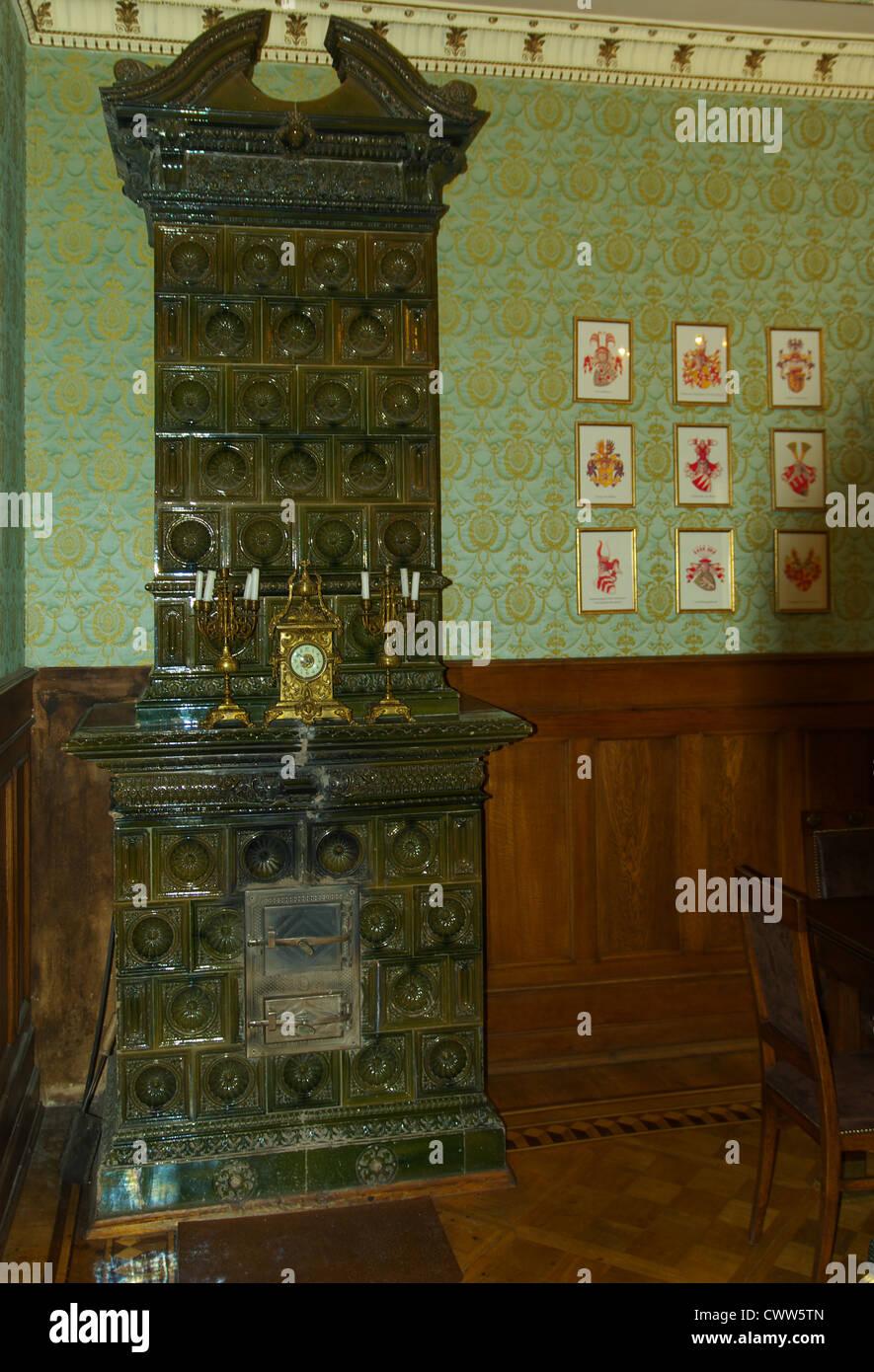 Tiled stove. - Stock Image