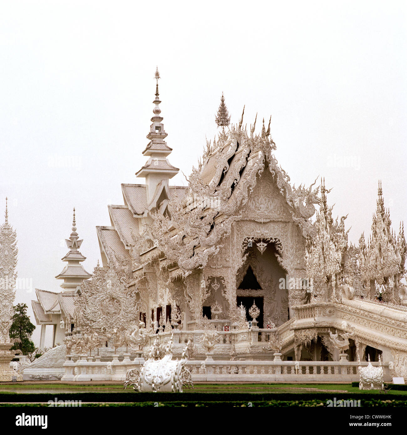 Wat Rong Khun White Temple Chiang Rai in Thailand in Southeast Asia Far East. Travel Religion Architecture Building Stock Photo