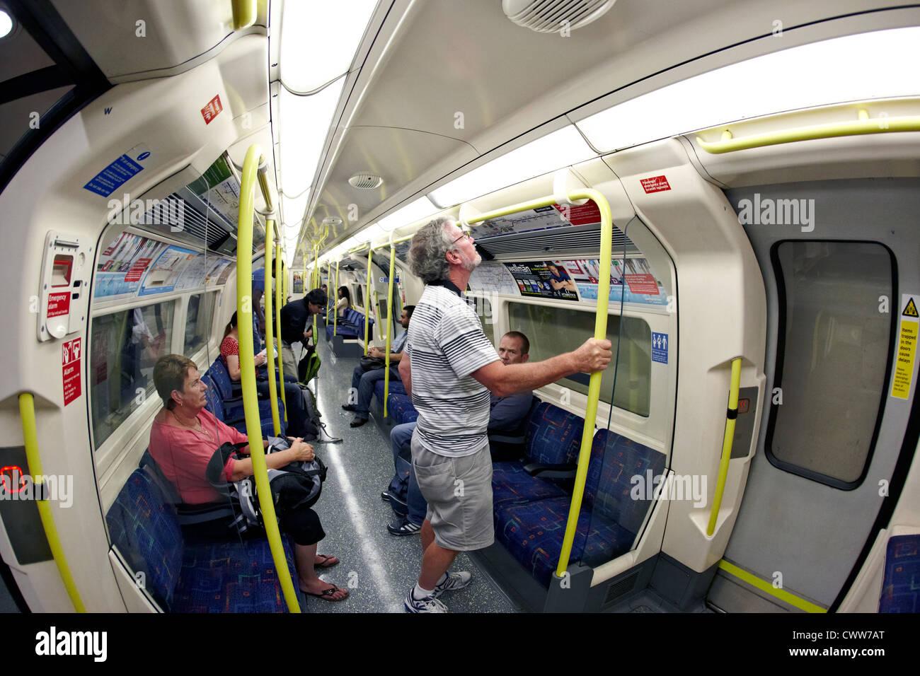 People on Tube Waterloo Underground Station London 2012 UK - Stock Image