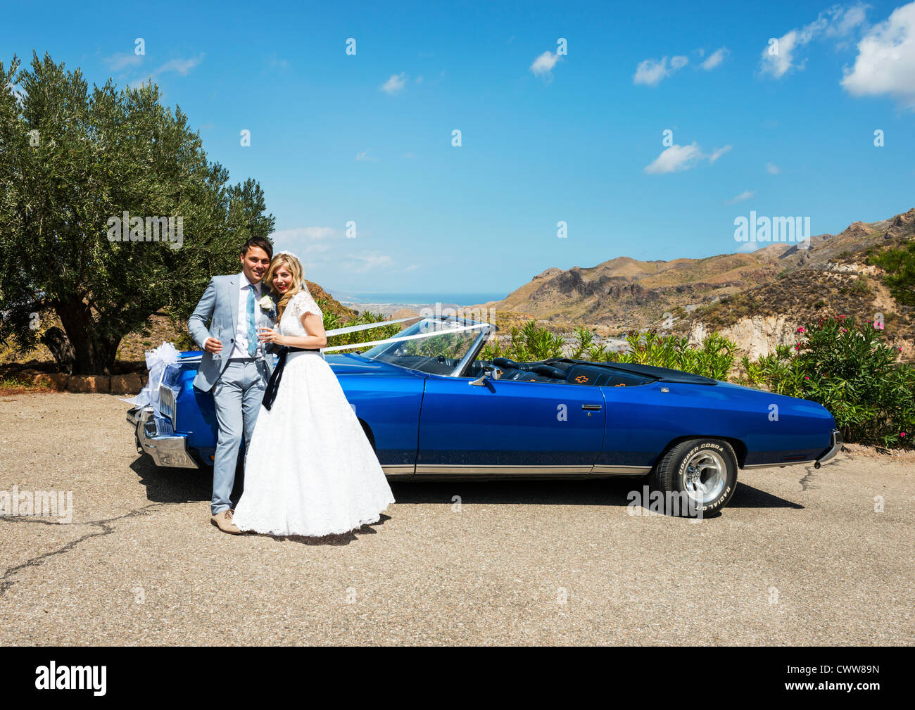 Bride Standing Next To The Wedding Car In The Spanish Sunshine Stock