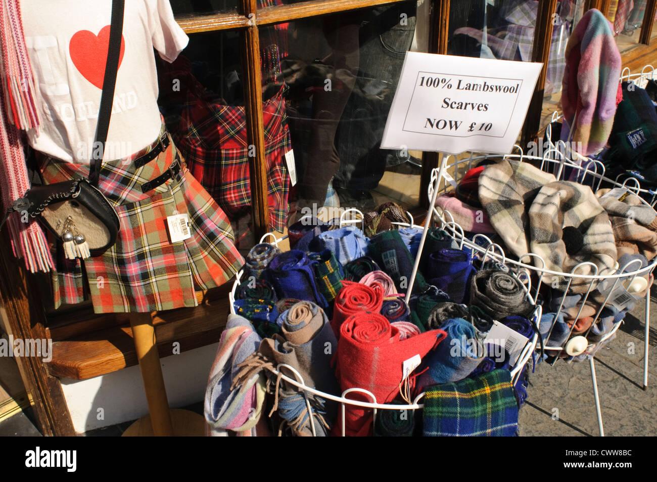 Tumble baskets of Scottish knitwear on The Royal Mile, Edinburgh. - Stock Image