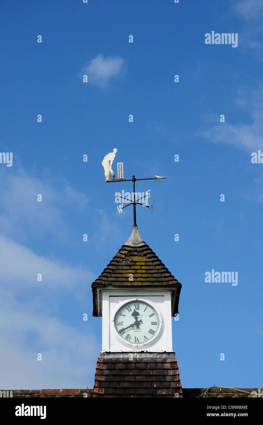 Clock and cricketing weather vane on Hobbs' Pavilion, Parker's Piece, Cambridge, England, UK (Sir Jack Hobbs) - Stock Image