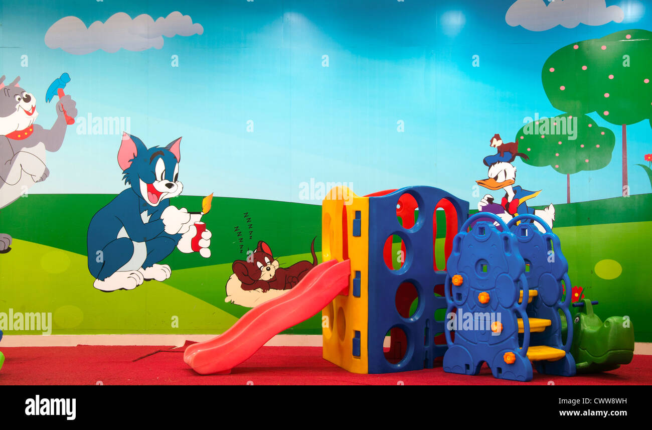 Toy house and slide in kindergarten, preschool - Stock Image