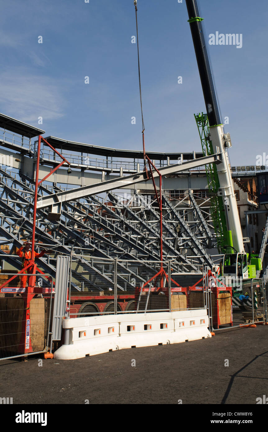 Construction crane dismantling temporary seating after the Edinburgh Military Tattoo - Stock Image