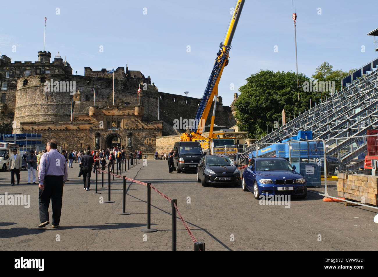 Construction crane dismantling temporary seating after the Edinburgh Military Tattoo Stock Photo