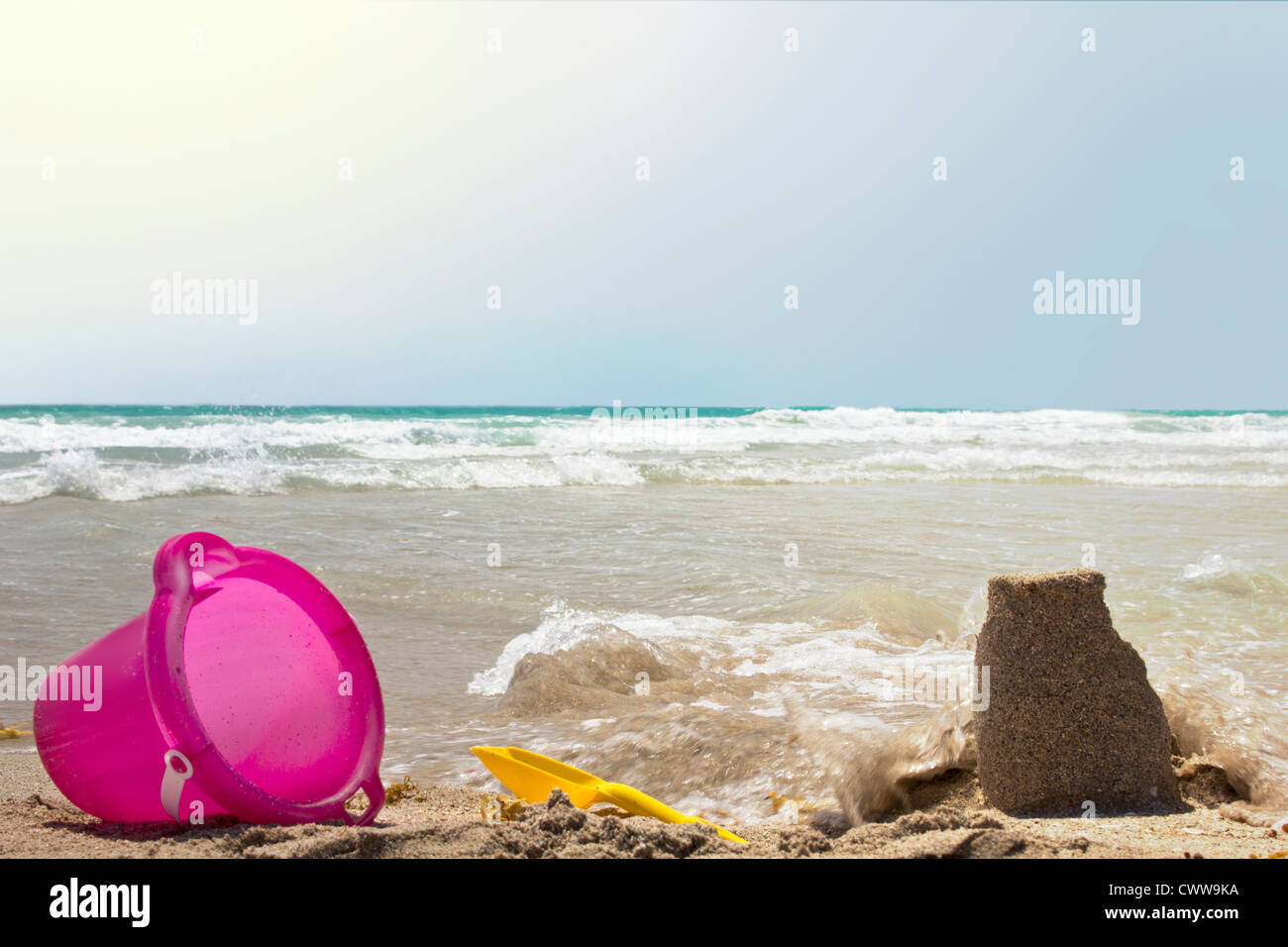 toys lying on the beach - Stock Image