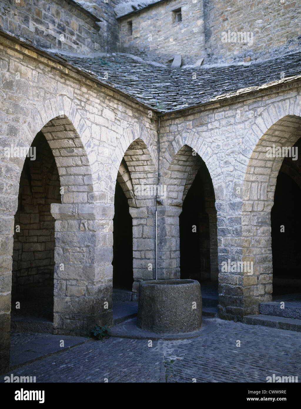 Spain. Aragon. Ainsa. Collegiate of St. Mary. Romanesque. Triangular cloister. - Stock Image