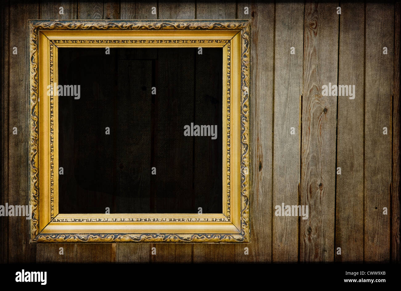 Golden Black Empty Frame On A Wooden Rustic Wall With Vintage Textured Editing