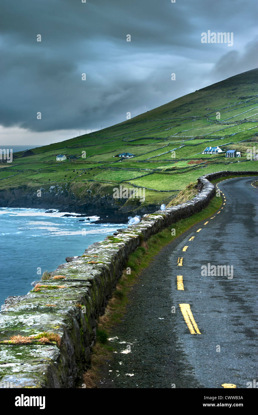Paved road along rural cliffs Stock Photo