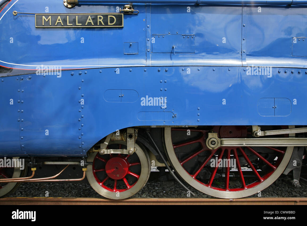 Driving wheels and nameplate of record-breaking preserved LNER Class A4 steam locomotive 4468 'Mallard'. - Stock Image