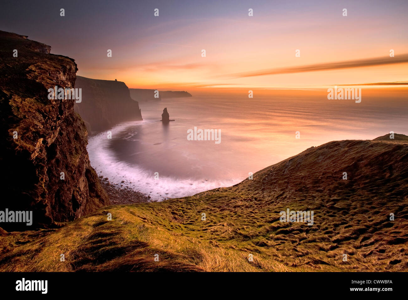 Waves crashing on rocky beach - Stock Image