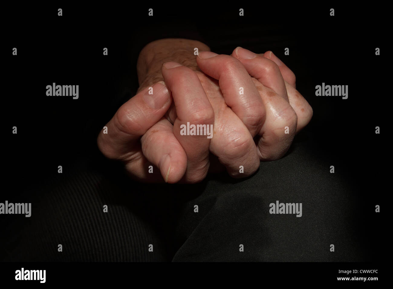 Mother and daughter holding their hands Stock Photo