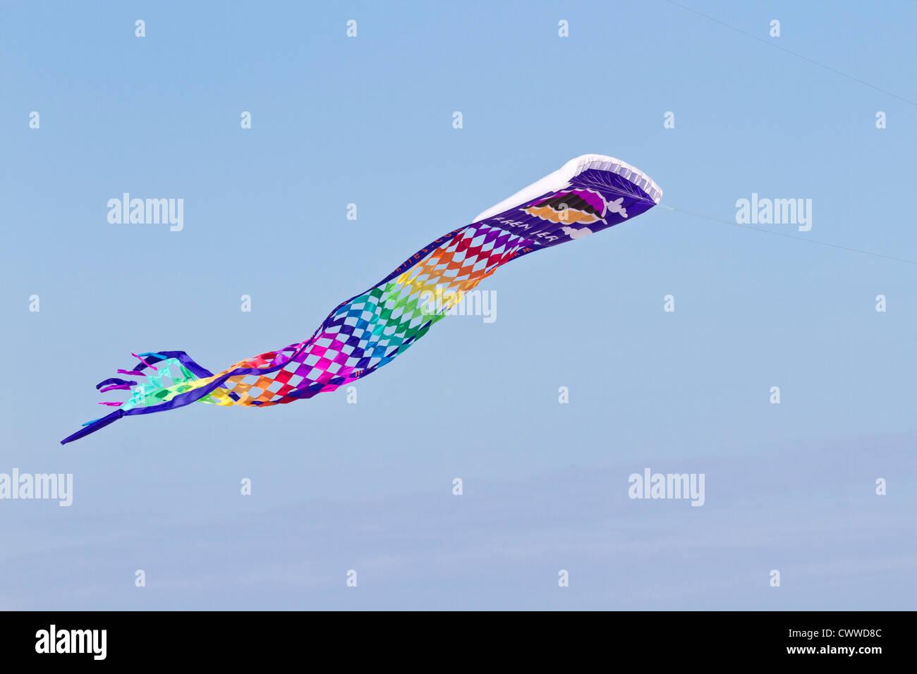 Colorful kite flying at the Treasure Island Kite Festival in Treasure Island, Florida - Stock Image