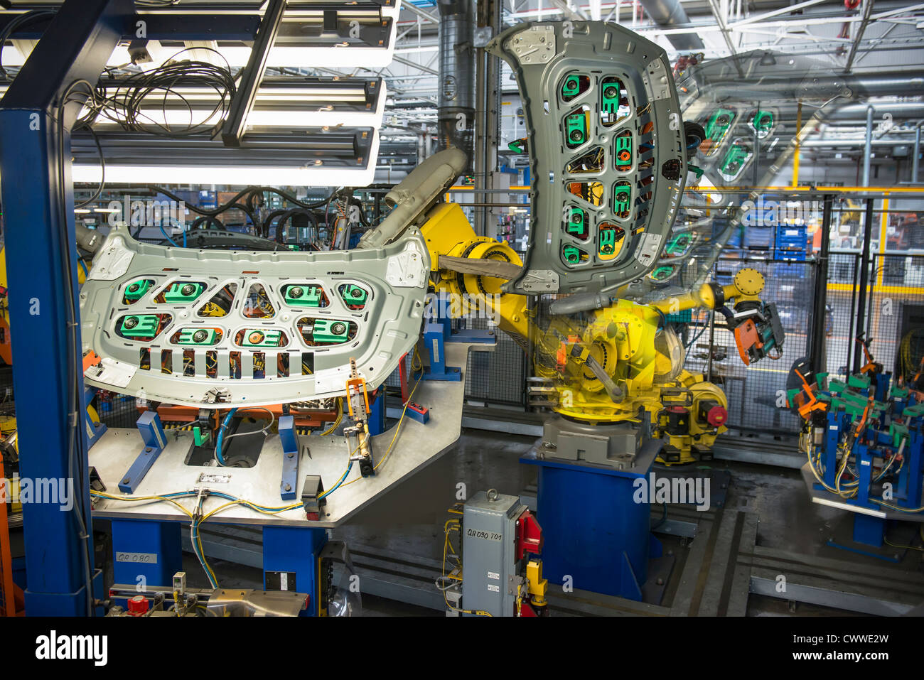Robots handling car parts in car factory Stock Photo