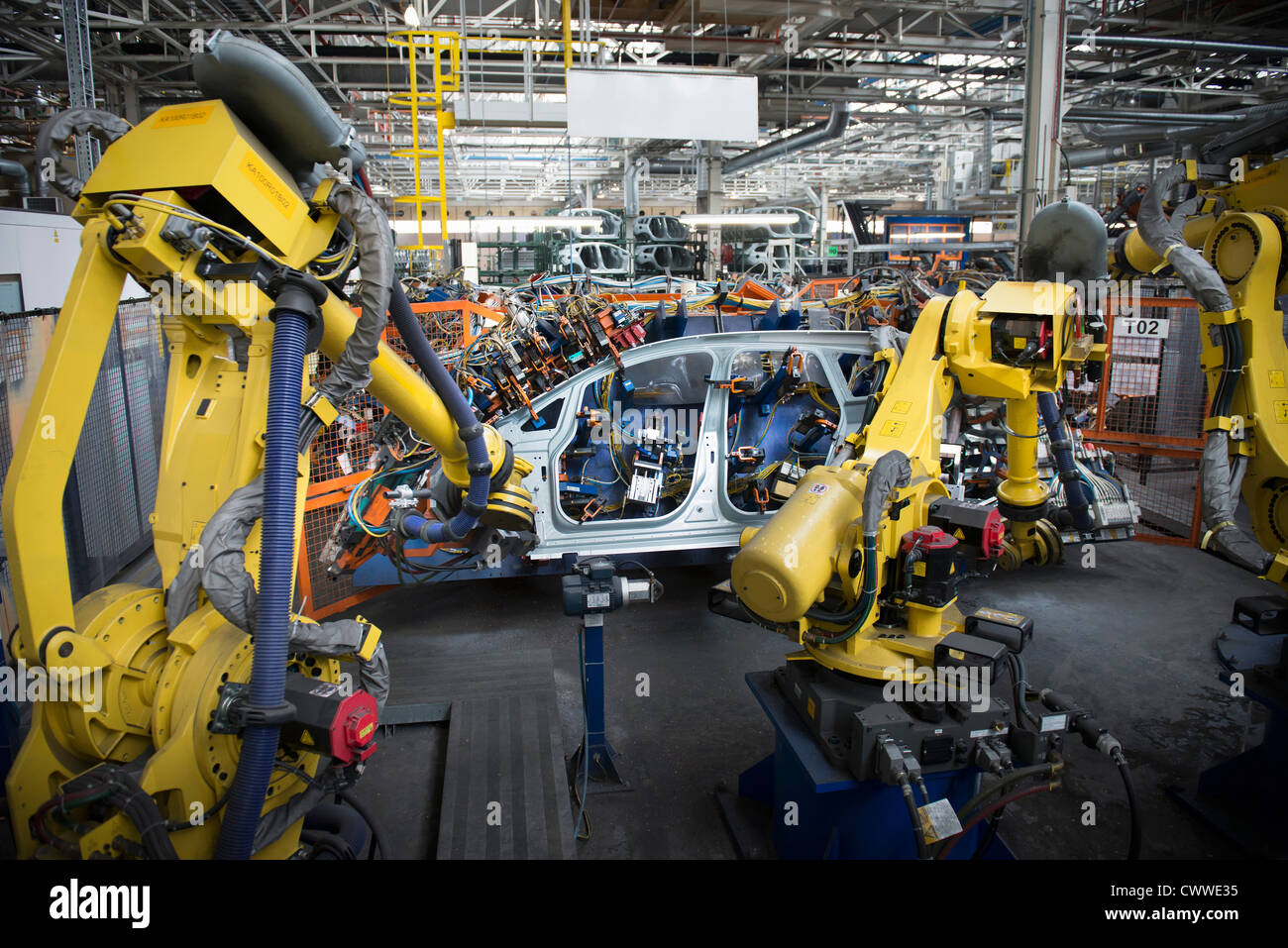 Robots welding car body in car factory - Stock Image