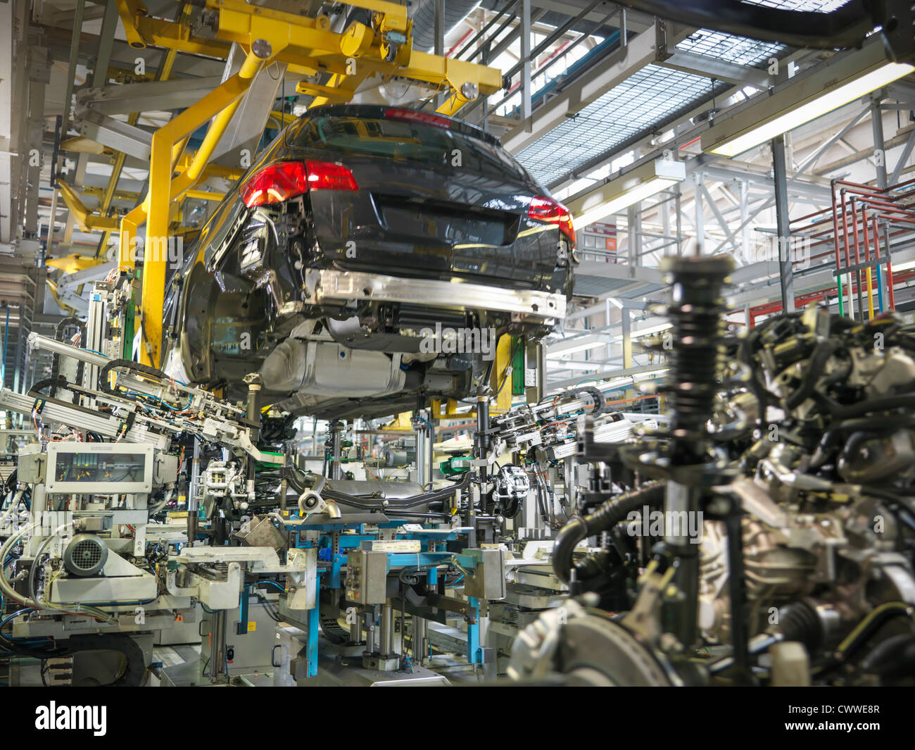Car body and engine transmission marriage in car factory - Stock Image