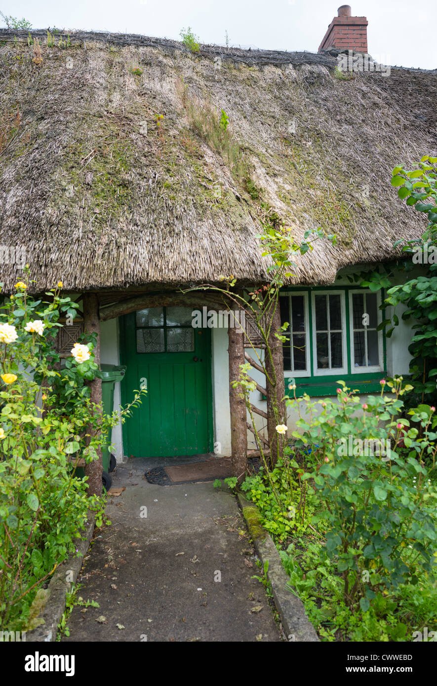 Traditional thatched cottage at Adare, county Limerick, Ireland. - Stock Image
