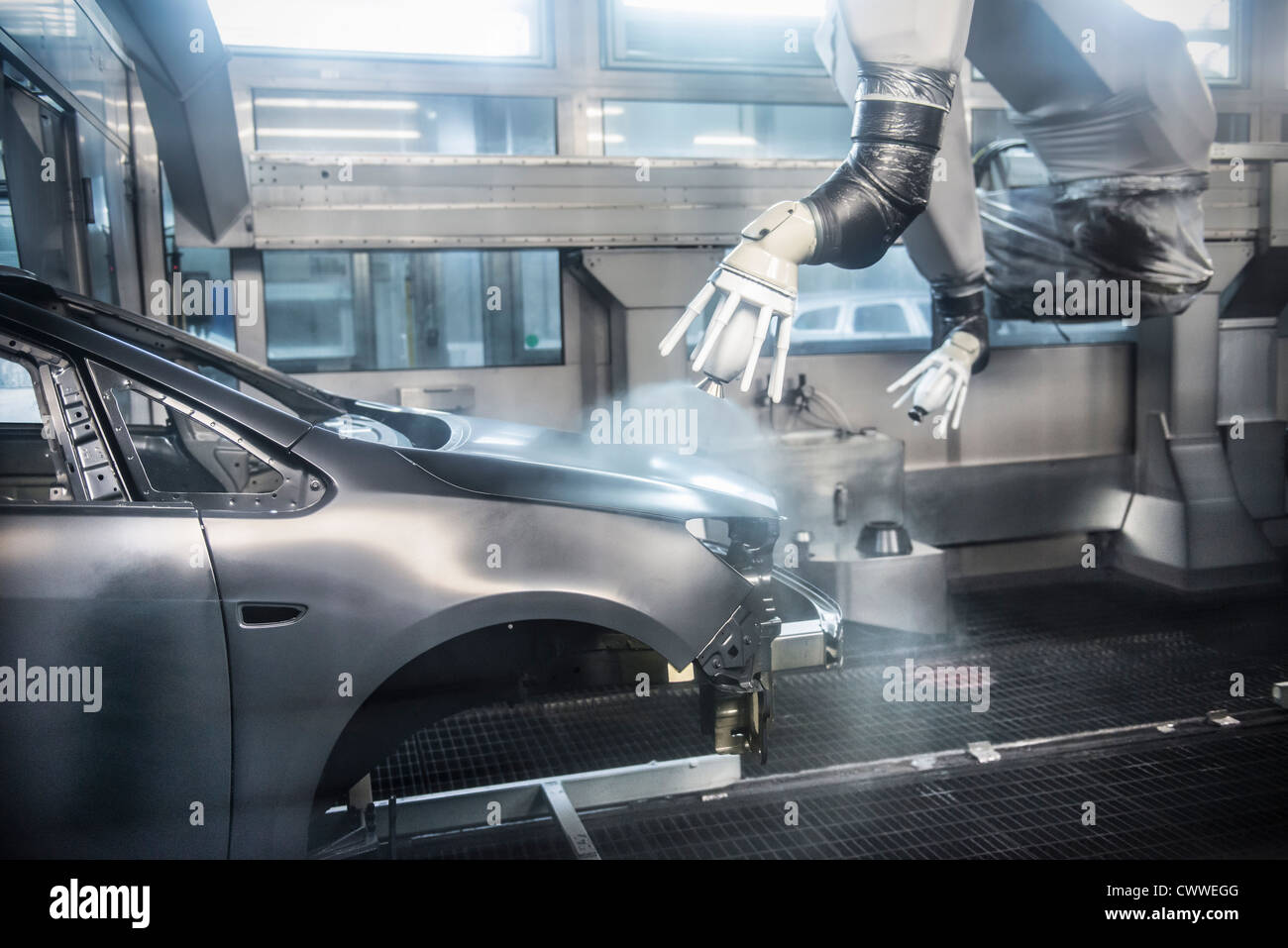 Paint spraying robots in car factory - Stock Image